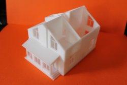 распечатанная на 3д принтере модель жилого дома первый и второй этажи